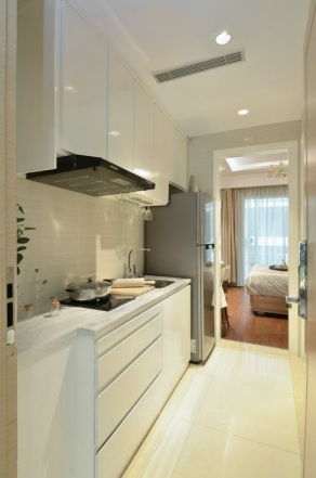 A modern white kitchen with laminate flooring