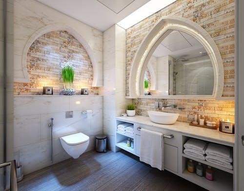 Stylish bathroom with storage space and towels and toiletries stored