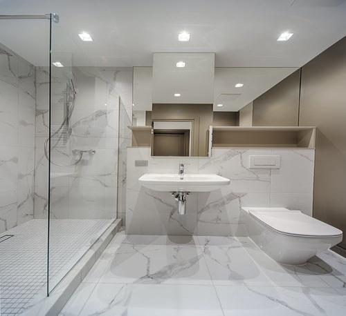 White modern bathroom with lighting and storage