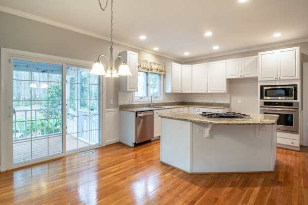 A Kitchen with White Fixture and SPC Flooring