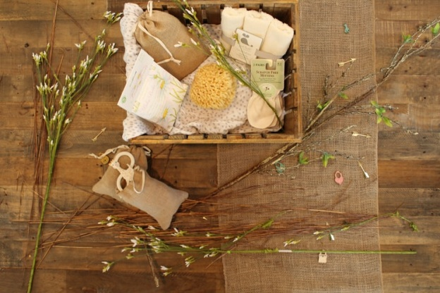 A wooden basket of assorted items against hardwood flooring